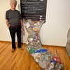 Illustrator/designer Will Winslow of Lowell designed a fishnet with all plastic and trash in it.