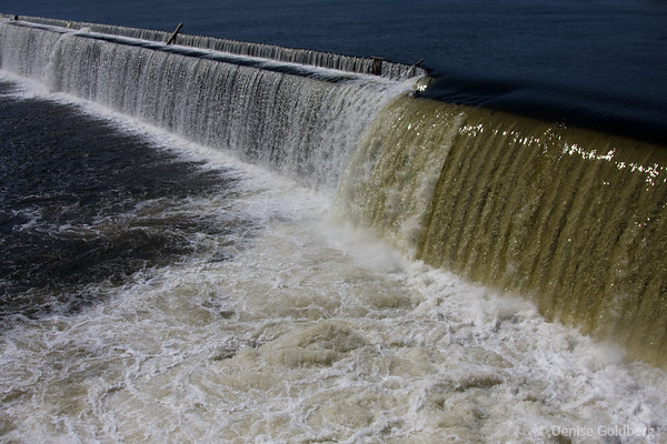 water flowing over Lawrence dam, April 2009