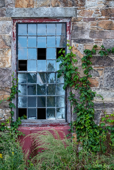 window in an old mill building in Lawrence, MA