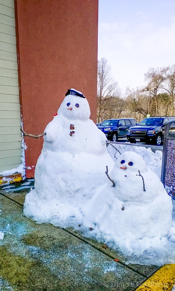 snow people, standing on the sidewalk at Whole Foods in Andover, MA