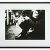 Monochrome giclee photograph of woman greeting man