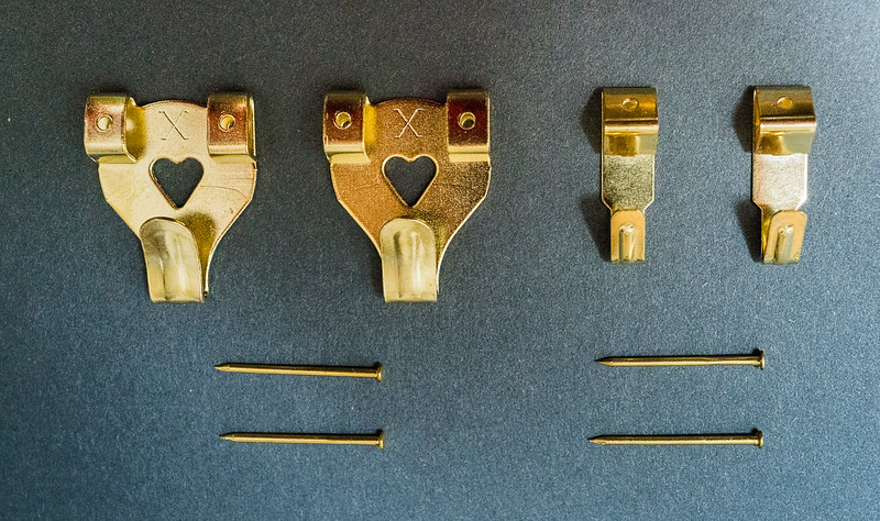 Picture hooks and pins.