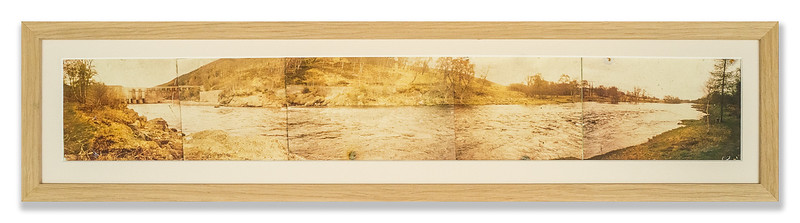 This is an old multi-photo panorama that was glued to a backing and had faded due to long exposure to light.