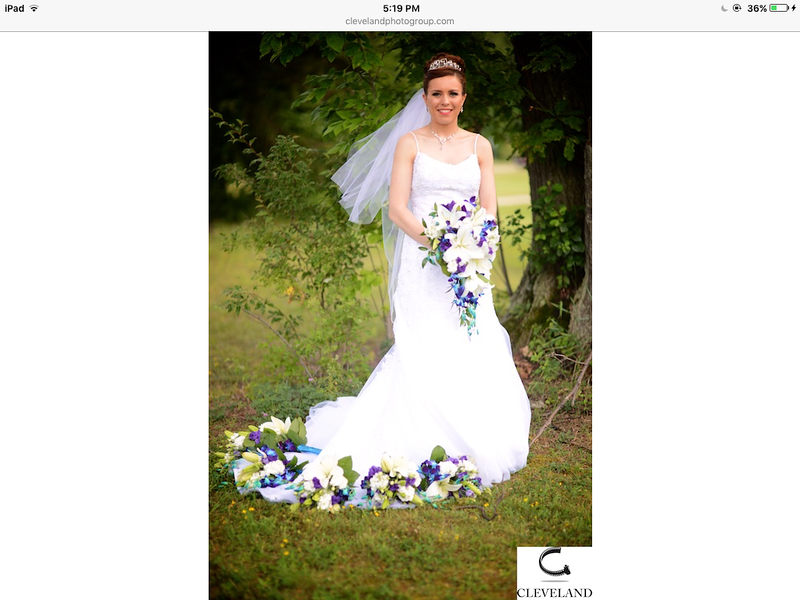 Allison with all of the bridemaids bouquets