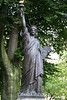 In the garden is one of three copies of the Statue of Liberty in Paris.