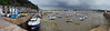 Erquy harbor at low tide with dramatic storm light - panorama