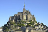 Mont St-Michel, closest overview.  Note street winding up from town to the three-story abbey topped by the church and spire.
