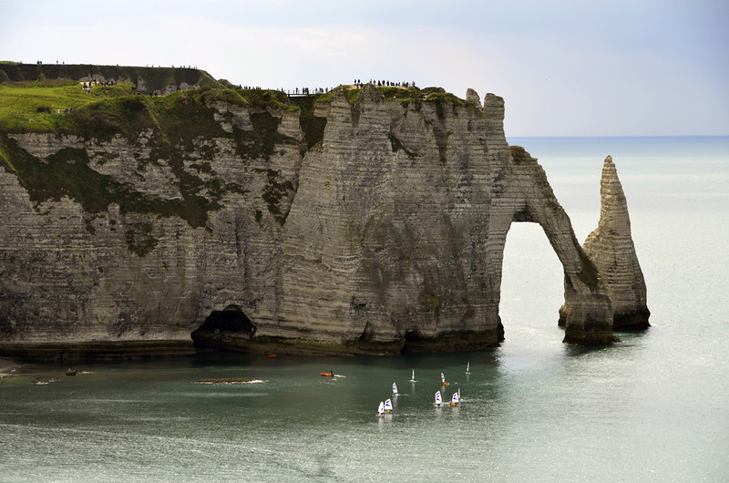 The arch and the needle west of Étretat, minga on cliffs, small boats below