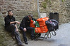 Mont St-Michel, employees of a hotel or restaurant, resting while schlepping up supplies for the day's business