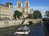Notre Dame by afternoon light with <i>bateau mouche</i>