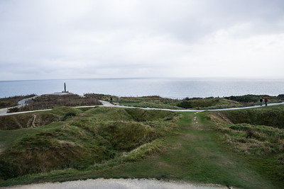 Pointe du Hoc, the huge cliffs rangers had to scale, still is pockmarked from the bombardment