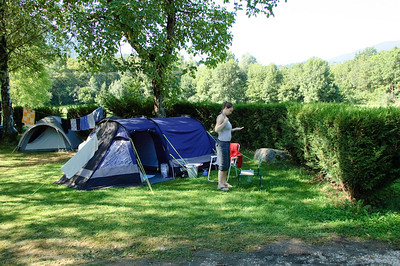 "Our Pitch for 8 Nights This was our pitch at Camping International - Lac d'Annecy.  Sadly it was a bit of a case of ""There's your spot and you can park your car opposite"".  We had to do a bit or precarious positioning of the tent to get a bit of privacy, but also so we didn't infringe on the people behind.  That said, it suited us perfectly with the only complaint being that it didn't get any sun until about 3pm each day, which means a slightly damp tent for quite some hours."