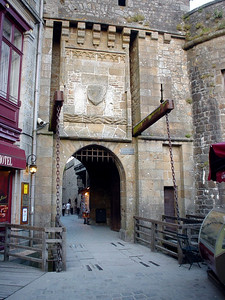 Mont-St-Michel Gate  The old gate with draw bridge at the entrance to the Mont-St-Michel town.