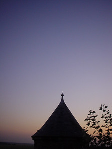 A Mosque?  My feeble attempt to place the moon at the tip of the spire of one of the turrets in a