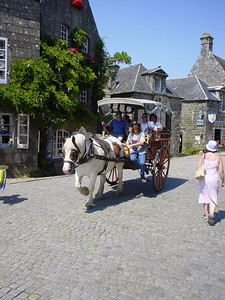 Horse Drawn Cart  A very tired looking horse pulling a cart round Locronan.  We didn't go for a trip as the poor horse looked really bored.  The man, cart and horse a feature of Locronan appearing on many post cards.