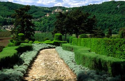 Marqueyssac Gardens with Castelnaud-la-Chapelle in the distance
