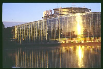 Sunrise reflecting on the European Parliament