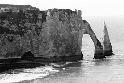 """The """"falaises"""" or chalk cliffs with the famous arch at Étretat looking south(B&W)"""