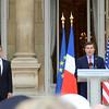 President Sarkozy listens as Ambassador Rivkin speaks
