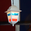 A lamp painted with the colors of the French flag