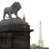 Lion statue, obelisk, and Eiffel Tower at Place de la Concorde