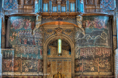This rood screen depicts the Last Judgement.  According to art historians, the area above the great door once depicted Christ overseeing the event.  However, the short-sighted souls in authority destroyed the painting of Christ in order to put in the pipes for the organ.  The cross from the ugly Vatican 2 altar can be seen sticking up in front of the great doors.