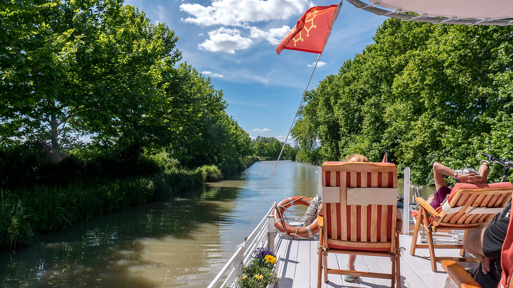 Relaxing aboard the Athos du Midi on the Canal du Midi, France