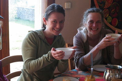 Sara and Shelia with bowls of morning coffee.