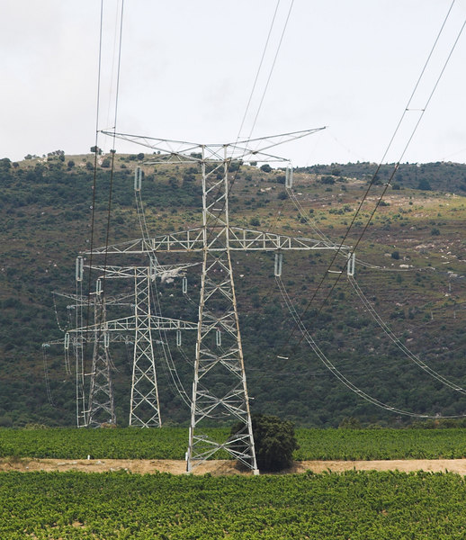 High tension electrical cables over a vinyard in Southern France.