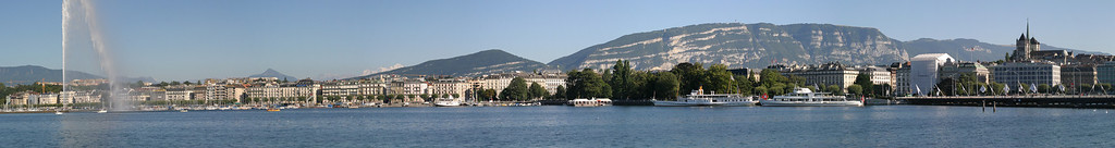 View of the Left Bank of Geneva, with Le Môle and Mont Blanc in the distant background at left, and the long ridge of Salève in the background on the right, from the Right Bank (Quai du Mont Blanc)