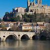 Beziers Cathedral rises above the river Orb, South of France