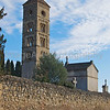 Romanesque tower in a walled cemetery in France