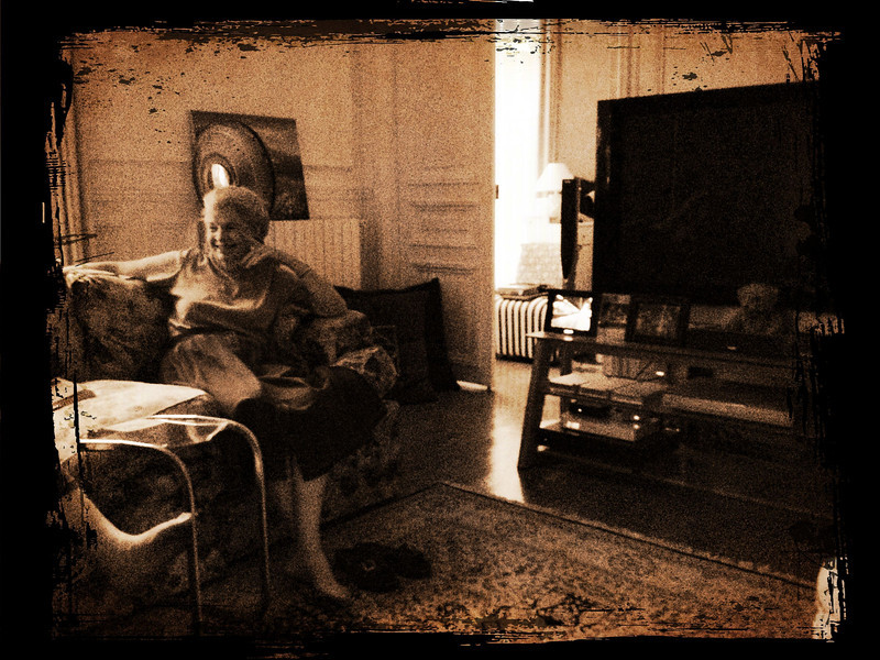 Mom B chatting with Deborah in our apartment in Paris.   (Photo modified with Camera Awesome.)