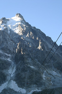 There are no support towers for the gondola between the mid-station and the summit; the trip is made in a single span.  The cables and a gondola car are visible in this image.