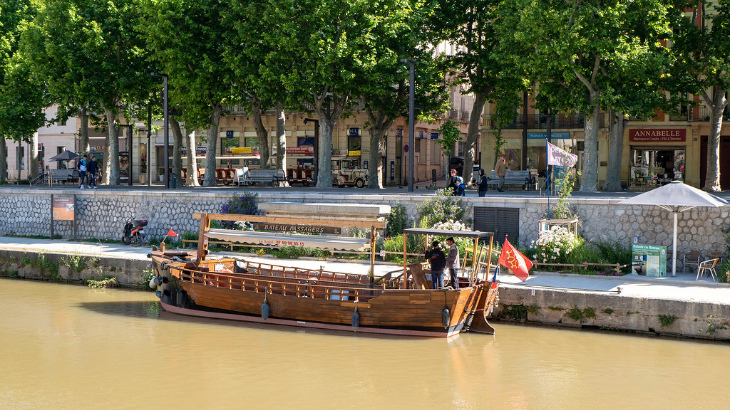 Old wooden boat on the Canal de la Robine in Narbonne France