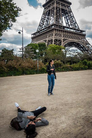 Getting a good photo angle on a friend with the Eiffel in the background.
