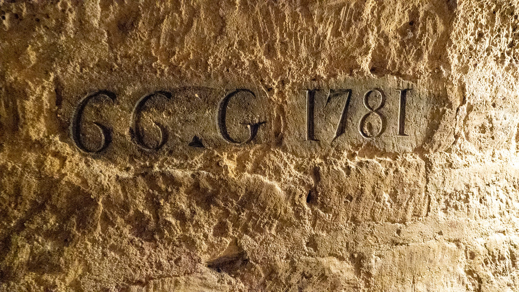 Paris Catacombs Tour - Visit the Catacombs of Paris, France - Writing and numbers in the walls
