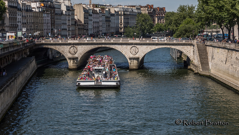 Crowded Sightseeing Boat on the Seine River<br /> Going Under the Pont au Change