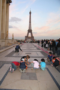 "Children lighting candles for ""Victims of Iraq"" near Eiffel Tower"