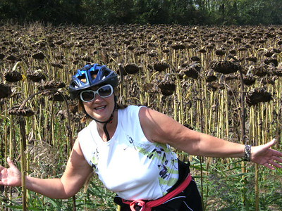 Judy in front of sunflower field