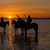 Sunrise and Three Herders