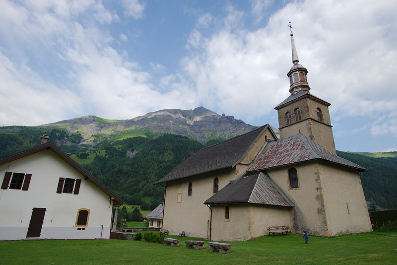 Oscar hanging out on the gorgeous grounds of Les Contamines' church