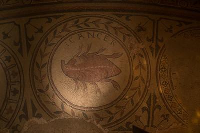 """Mosaic depicting the zodiak sign """"Cancer.""""  Abbaye de Saint-Philibert, Tournus."""