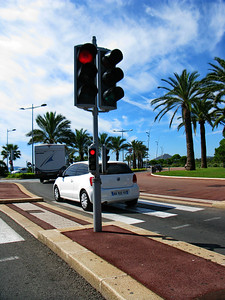 Two sets of stop and go lights; Nice, France.  Here is something else I've never seen elsewhere.  Two sets of stop and go lights, one high and typical size and a smaller set lower down making it more visible to the driver.