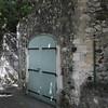 Blue-Gray Doors in Stone Wall