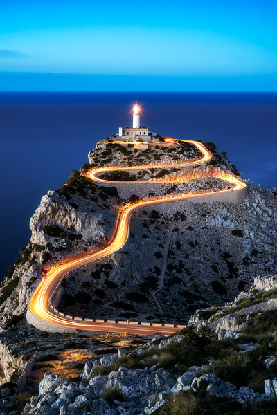 Fotopoint Cap Formentor with city and lighttrails in the evening