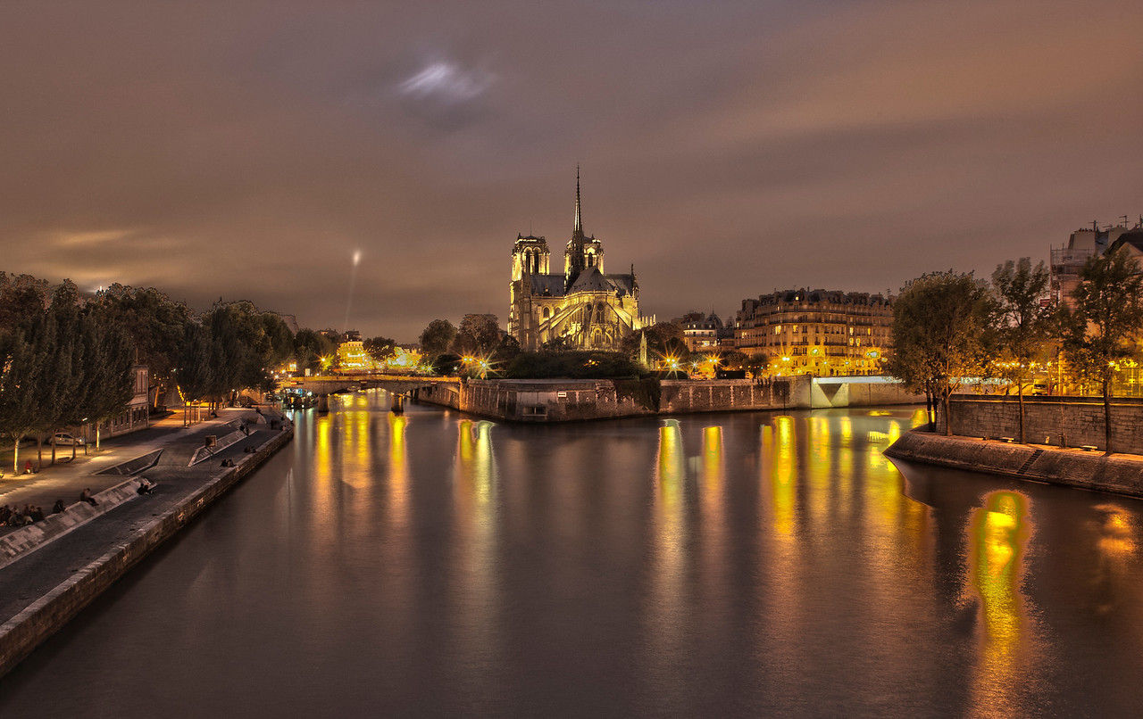 Rear view at night of Notre Dame Cathedral, the Ile de la Cité and the River Seine