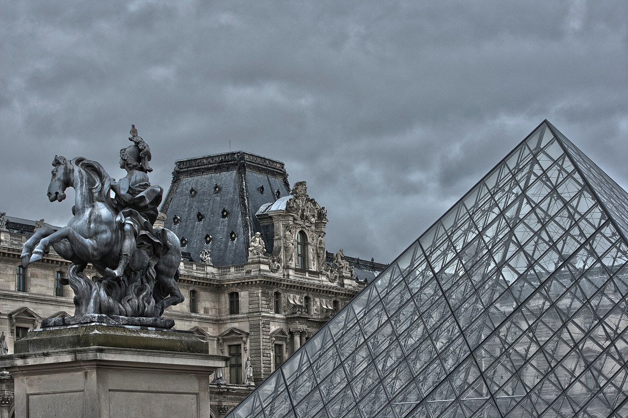 Glass Pyramid & Statue in front of the Louvre Museum in Paris, France