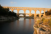 Pont du Gard. An ancient (1st century A.D.) Roman aquaduct that crosses the Gardon River.  Part of the Nimes aqueduct.  18 feet high; 902 feet long; 17 foot downward left-to-right slope.   A UNESCO World Heritage site.  , 1st century A.D.  Vers-Pont-du-Gard, France.