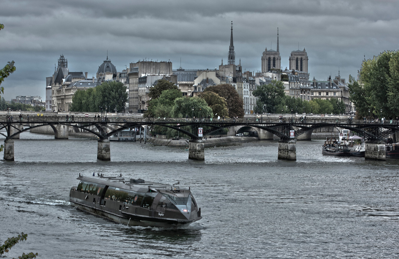 River Boat on the River Seine in front of Notre Dame in Paris